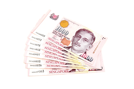 Singapore Dollars on a white background. Stock Photo