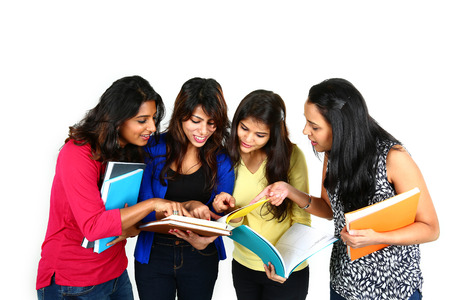 Group of Indian college students studying. Isolated on white background Stock Photo