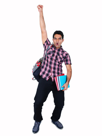 Portrait of young Indian student jumping with joy isolated on white background