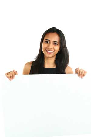Indian Business Woman displaying white placard for your text. Isolated portrait on white. photo