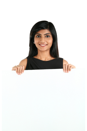 Indian Business Woman displaying white placard for your text. Isolated portrait on white.