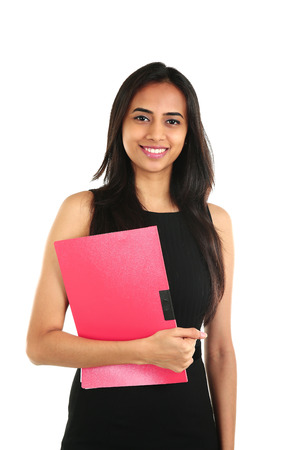 Close up portrait of a smiling Indian business woman with a folder. isolated on white.