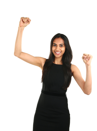 Portrait of successful and excited Asian business woman celebrating a triumph  - isolated over a white background
