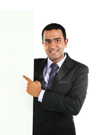 Indian Business man displaying white placard for your text. Isolated portrait on white. Stock Photo