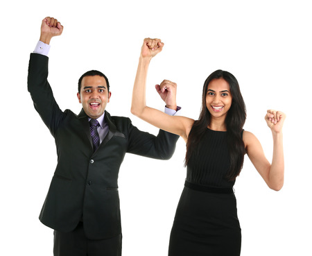 Portrait of successful and excited Asian businessman and business woman celebrating a triumph, isolated over a white background. Team work concept. Stock Photo