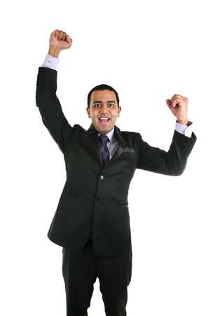 Portrait of successful and excited Asian business mancelebrating a triumph - isolated over a white background Stock Photo