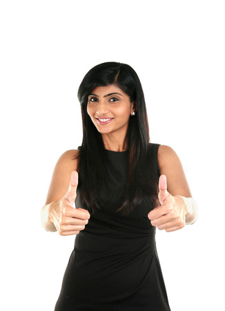Happy beautiful Indian girl showing thumb up symbol by two hands. Isolated on white background.