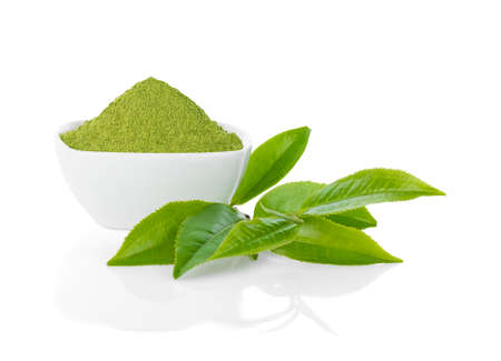 Green tea powder and green tea leaf isolated on white background.