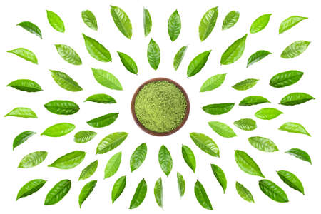 Green tea leaf with green tea powder in wooden cup isolated on white background.