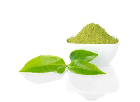 Powder green tea and green tea leaf on white background 免版税图像