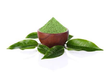 Green tea Powder and green tea leaf isolated on white backgroun. 免版税图像