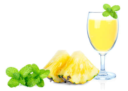Beautiful fruit drink glass of pineapple juice and slices pineapple with peppermint leaf isolated on white background. 免版税图像
