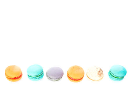Cake macaron or macaroon on white background from above, colorful pastel colors, vintage card, top view, leaves