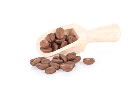 Wooden shovel with roasted coffee beans in white background