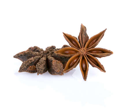 Two Chinese star anise spice fruits and seed isolated over the white background 免版税图像 - 148686994