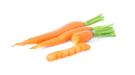 Fresh carrot and cut pieces isolated on white background 免版税图像