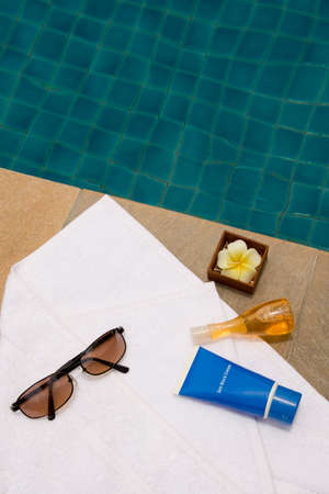 swimming candles: Sunglasses, bath towel, sun block cream, bath jel and candle