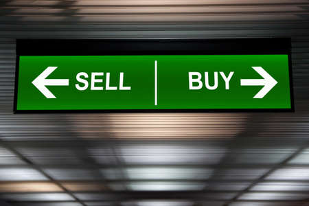 conjuncture: Financial concept. Sell and Buy Arrows sign, indicated stock market activity.