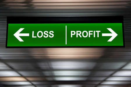 Financial concept. Loss and Profit Arrows sign, indicated stock market activity.