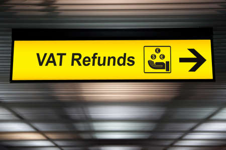 Airport Tax refund and customs sign in terminal at airport Archivio Fotografico