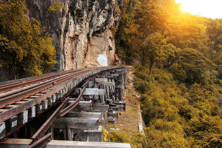 hellfire: Train ride on the Death railway (river Kwai, Thailand). Death Railway train passing over the Tham Krasae Viaduct. Thai-Burma Railway