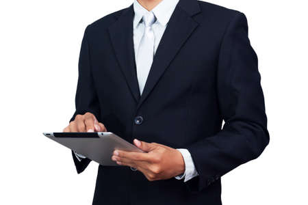 Asian businessman in suit formal wear using tablet computer isolated on white background with clipping path. Asia male model in his 30s