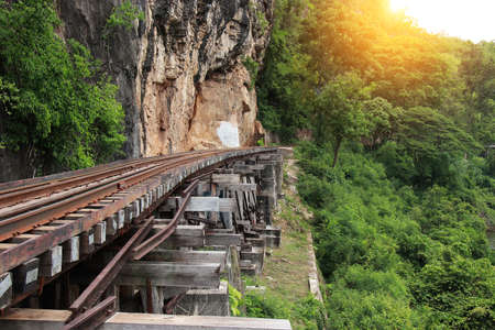 Train ride on the Death railway (river Kwai, Thailand). Death Railway train passing over the Tham Krasae Viaduct. Thai - Burma Railway Stock Photo