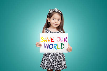 ittle: Save world save life save the planet, the ecosystem, green life concept. Little cute child girl with colorful sign save our world with green color background Stock Photo