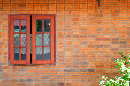 window view: Vintage simple house old brick wall and rustic exterior window shutters at countryside in Asia