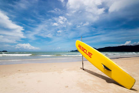 lifeguard surf rescue surfboard on the beach at rescue guard point with big wave ocean at background. helping , security and rescue concept