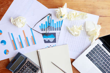 accounting, banking and statistic data concept. accounting work space with calculator, profit paper work and computer on wooden tables, top view Stock Photo
