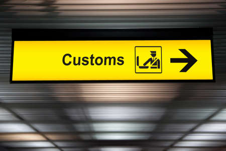 airport customs declare sign with icon and arrow hanging from airport ceiling at international terminal. customs declare for import and export concept Standard-Bild