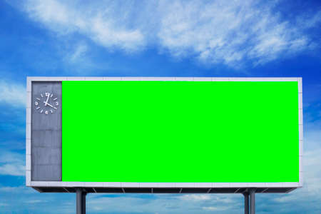 empty blank green screen billboard sign with blue sky at background