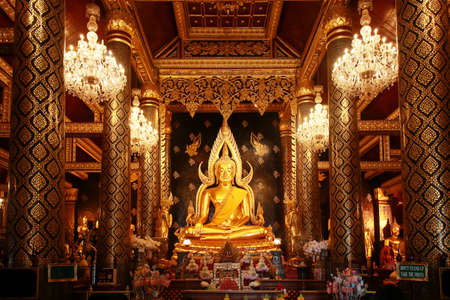 beautiful big golden buddha statue name Phra Phuttha Chinnarat at Wat Phra Si Rattana Mahathat temple. calm and peaceful face of worship buddha statue illuminated. Buddhism religion concept