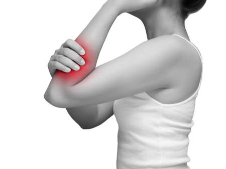woman suffering from arm pain, painful in arm muscles. mono tone color with red highlight at arm , arm muscles isolated on white background. health care and medical concept. studio shot