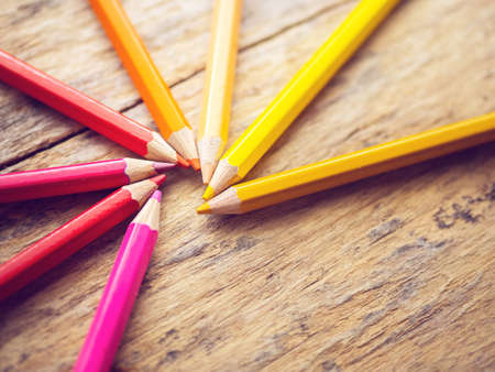 colorful color pencils on old wooden table with copy space Archivio Fotografico - 115991637