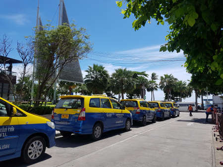 PATTAYA, THAILAND - JUNE 29: blue yellow taxi-meters cab parking in the parking lots side of Central Festival Pattaya Beach shopping store on the JUNE 29, 2018 in PATTAYA, THAILAND