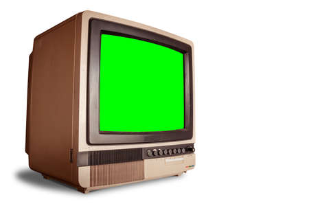 side view of old retro home TV receiver with blank green screen isolated on white background with clipping path