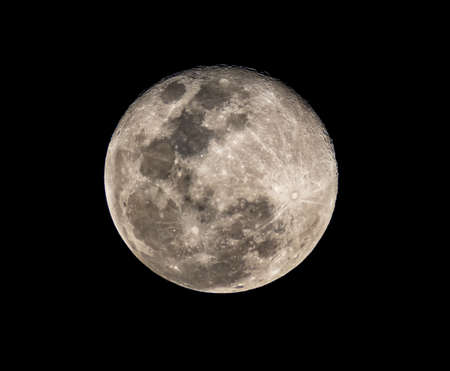 high resolution full moon photo from telescope isolated on black background