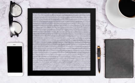 free word on blank letter board in grey color on white marble desk background with coffee cup , notebook , pen , glasses and mobile phone , flat lay composition in black tone stationery color