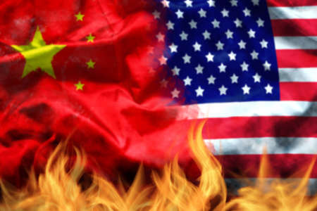 waving USA and China flag with fire on foreground. serious trade tension or trade war between US and China, financial concept Stok Fotoğraf
