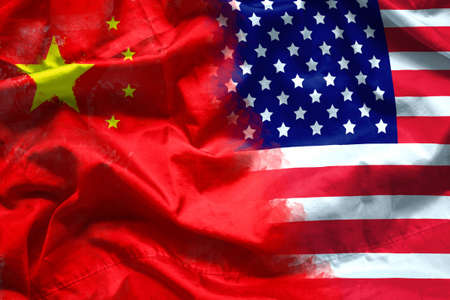 waving USA and China flag. multinational company investment between US and China, financial concept