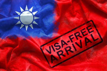 free visa for visitor to entry to Taiwan country, visa free arrival stamp on Taiwan flag background. oversea travel in visa free arrival country concept