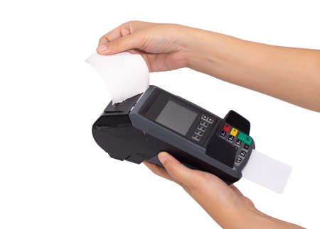 close up of merchant hand split receipt paper from credit card swipe machine at point of sale terminal, clipping path include 写真素材