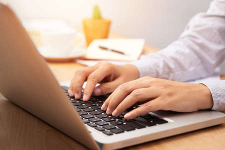 businesswoman working with notebook laptop computer, using finger with keyboard for typing or keying