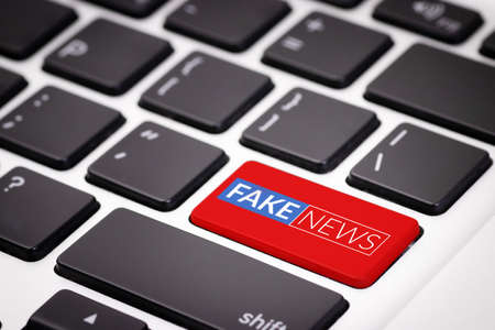 red fake news button on laptop keyboard. fake news on internet in modern digital age concept Reklamní fotografie