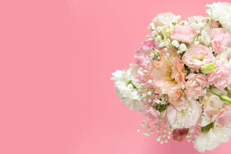 top view of beautiful romantic bouquet fresh spring flower on pink background with copy space