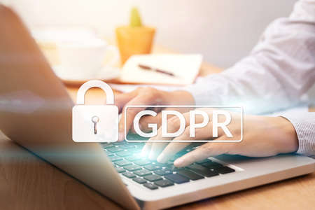 cyber security and privacy concept. people using personal computer with text GDPR or General Data Protection Regulation text secure with a padlock logo.
