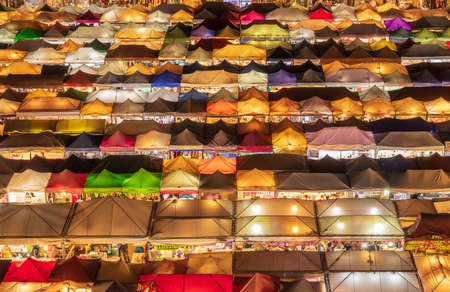 top view of busy Asian street food at railway night market in Thailand with colorful stall and light at night time Editorial