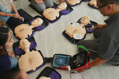 BANGKOK, THAILAND - OCTOBER 6, 2019 : a part of trainee , participant of CPR First Aid Training course using hand pump on chest of dummy for primary safe life in Bangkok, Thailand on October 6, 2019 報道画像